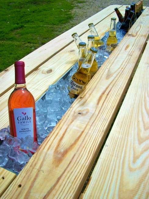 A picnic table with a gutter becomes a drink cooler picnic table drink cooler idea watchthetrailerfo