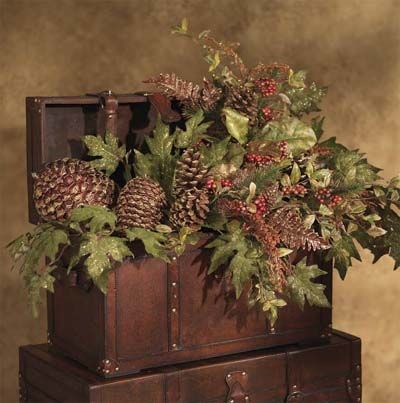 Wooden trunks filled with Pine Cones and Greenery